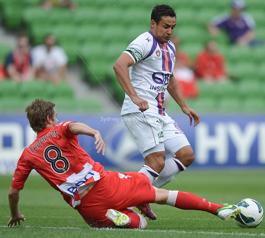 MELBOURNE - 8 DEC: Matt THOMPSON of the Heart tackles Travis DODD of the Glory in the round ten A-League match between the Melbourne Heart and Perth Glory at AAMI Park on 8 December 2012. (Photo Sydney Low/syd-low.com/Melbourne Heart)