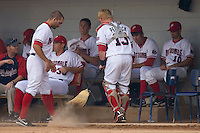 Brian Peacock #13 of the Potomac Nationals sweeps the dugout at Pfitzner Stadium June 10, 2009 in Woodbridge, Virginia. (Photo by Brian Westerholt / Four Seam Images)