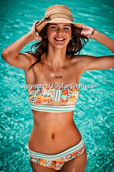 Kendall Jenner swimwear collection Agua Bendita summer 2014<br /> <br /> <br /> &copy; DJ / Target Press - 16/09/2013 - *Hands Out Pics*