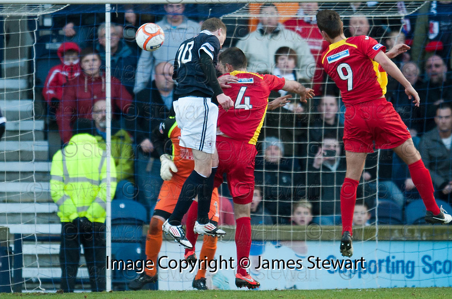Raith's Pat Clarke scores Rovers' goal  ...