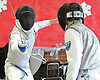Philip Acinapuro of Garden City, left, battles Matthew Gigante of Great Neck South in a foil bout during a fencing meet at Garden City High School on Saturday, Jan. 9, 2016. Acinapuro won the bout 5-0.