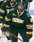 Jonathan Turk (UVM - 8) - The visiting University of Vermont Catamounts defeated the Northeastern University Huskies 6-2 on Saturday, October 11, 2014, at Matthews Arena in Boston, Massachusetts.