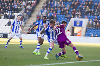 Stefan Scougall of Carlisle United tussles with Sammie Szmodics of Colchester United during Colchester United vs Carlisle United, Sky Bet EFL League 2 Football at the JobServe Community Stadium on 23rd February 2019