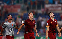Calcio, Champions League, Gruppo E: Roma vs CSKA Mosca. Roma, stadio Olimpico, 17 settembre 2014.<br /> From left, Roma defender Ashley Cole, of Britain, forward Francesco Totti and defender Kostas Manolas, of Greece, greet fans at the end of the Group E Champions League football match between AS Roma and CSKA Moskva at Rome's Olympic stadium, 17 September 2014. AS Roma won 5-1.<br /> UPDATE IMAGES PRESS/Isabella Bonotto
