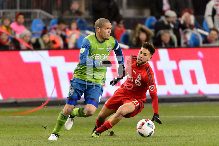 Toronto, ON, Canada - Saturday Dec. 10, 2016: Osvaldo Alonso, Jonathan Osorio during the MLS Cup finals at BMO Field. The Seattle Sounders FC defeated Toronto FC on penalty kicks after playing a scoreless game.