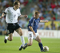John O'Brien controls the ball as Dietmar Hamann looks on. The USA lost to Germany 1-0 in the Quarterfinals of the FIFA World Cup 2002 in South Korea on June 21, 2002.