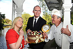 Tuesday May 13th 2014: REPRO FREE: Mullingar food producer and Chocolatier Olivia Curran and Artie Clifford, Chairman tempt Minister for Agriculture, Marine and Food Simon Coveney with her edible chocolate hat in St. Stephen's Green Dublin on Tuesday morning prior to the launch of the annual Blas na h-Eireann / Irish Food Awards which take place in Dingle County Kerry. <br /> A survey of Irish food producers has found that 70% of small to medium sized producers feel that a lack of financial advice and support is the biggest challenge they face in growing their businesses. The survey, conducted on behalf of the Blas na hEireann, Irish Food Awards, also found that for 65% of producers distribution is a major problem; not only nationally but also internationally.<br /> <br /> The findings of this survey, titled &ldquo;Producer Power in 2014&rsquo;, were announced at the launch of the 7thAnnual  Blas na hEireann 2014 Awards, which took place at The Westbury Hotel, Dublin, on Tuesday 13 May, where Minister Simon Coveney, a former producer himself, made the opening address.<br /> <br /> The Blas na hEireann, Irish Food Awards accreditation is the largest competition of its kind in Ireland attracting over 2,000 entries annually. It was set up to reward and support the best of Irish produce and the passionate, talented producers behind it. Award winners get to display the Blas na hEireann symbol on their products which previous, independent research shows leads to an increase in sales.  All entries are blind tasted by a team of over 350 judges in two tranches, including top chefs, journalists, industry experts, inspired home cooks and academics.  The judging system was developed and is overseen each year by Dr Joe Kerry and his team from the School of Food and Nutritional Science at UCC.   The Award winners in over 80 food categories will be presented at an Awards Ceremony in Dingle, Co Kerry on Saturday 4 October, to co-incide with the peninsula's hugely popular food and wine festival.  In addition Bord Bia sp