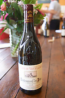bottle with moulded relief on the neck domaine du vieux lazaret chateauneuf du pape rhone france