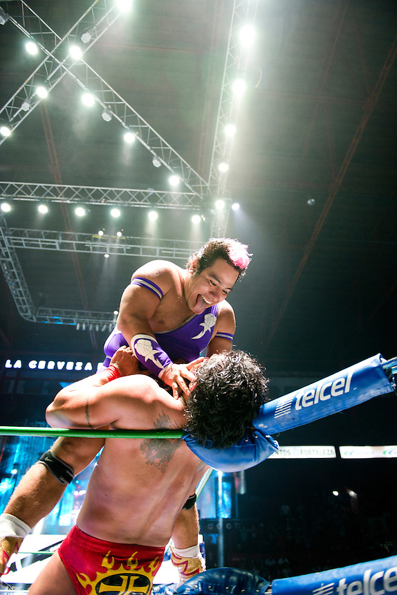 """Maximo a Lucha Libre wrestler, is an """"Exotico"""" meaning he fights as a gay Luchador,  gives a kiss to hi opponent in the ring at Arena Mexico. Mexico City"""