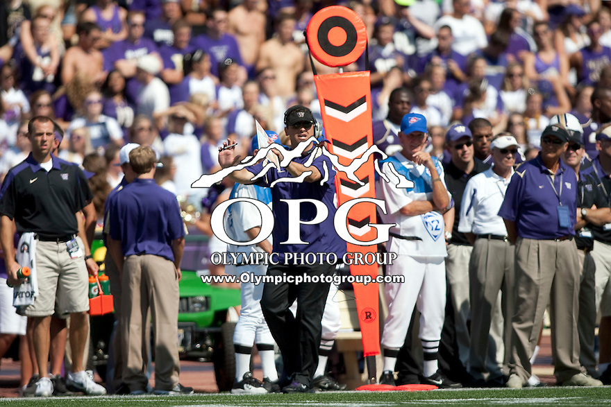 Sept 9, 2011:  Washington head coach Steve Sarkisian signals to his players from the sidelines against Hawaii.  Washington defeated Hawaii 40-32 at Husky Stadium in Seattle, Washington...