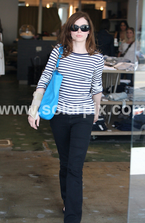 **ALL ROUND PICTURES FROM SOLARPIX.COM**.**WORLDWIDE SYNDICATION RIGHTS**.**NO PUBLICATION IN THE USA, AUSTRALIA OR GERMANY**.Rose McGowan, the star of the TV series Charmed and the new movie Red Sonja, was spotted in Beverly Hills going to Starbucks with a wrist brace on her right hand. Rose told photographers she was fine but her brace was the wrong size. Beverly Hills, Los Angeles, CA, USA. 29th July 2008..This pic: Rose McGowan..JOB REF: 6933 LAS        DATE: 29_07_2008.**MUST CREDIT SOLARPIX.COM OR DOUBLE FEE WILL BE CHARGED* *UNDER NO CIRCUMSTANCES IS THIS IMAGE TO BE REPRODUCED FOR ANY ONLINE EDITION WITHOUT PRIOR PERMISSION*