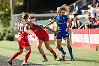 Seattle, WA - Saturday, August 26th, 2017: Beverly Yanez and Allie Long during a regular season National Women's Soccer League (NWSL) match between the Seattle Reign FC and the Portland Thorns FC at Memorial Stadium.