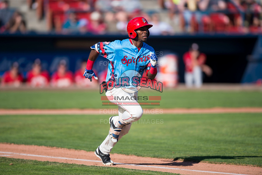 Spokane Indians center fielder Julio Pablo Martinez (27) hustles down the first base line during a Northwest League game against the Vancouver Canadians at Avista Stadium on September 2, 2018 in Spokane, Washington. The Spokane Indians defeated the Vancouver Canadians by a score of 3-1. (Zachary Lucy/Four Seam Images)