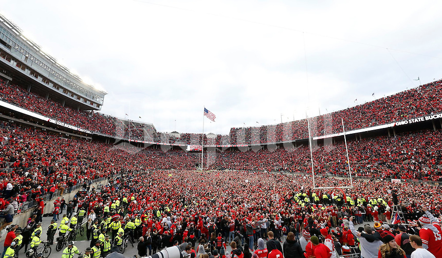 Ohio State fans stormed the field after the Buckeyes beat the Michigan Wolverines 30-27 in double overtime during Saturday's NCAA Division I football game at Ohio Stadium in Columbus on November 26, 2016. (Barbara J. Perenic/The Columbus Dispatch)