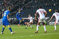 Lyle Taylor of AFC Wimbledon (2nd left) shoots during the Sky Bet League 1 match between MK Dons and AFC Wimbledon at stadium:mk, Milton Keynes, England on 13 January 2018. Photo by David Horn.