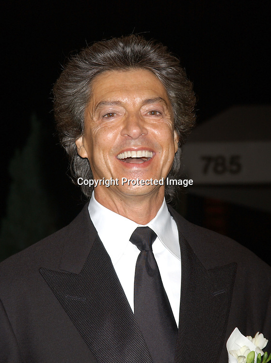 ..Tommy Tune ..arriving at Arlene Dahl and Marc Rosen's 20th Anniversary ..party at Doubles on September 30, 2003 in New York City. ..Photo by Robin Platzer, Twin Images