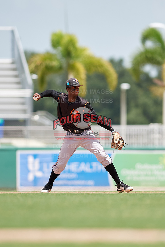 GCL Orioles second baseman Carlos Baez (1) throws to first base during a game against the GCL Red Sox on August 9, 2018 at JetBlue Park in Fort Myers, Florida.  GCL Red Sox defeated GCL Orioles 10-4.  (Mike Janes/Four Seam Images)