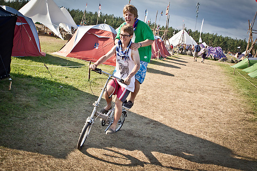 Two scouts take a risky ride in camp.