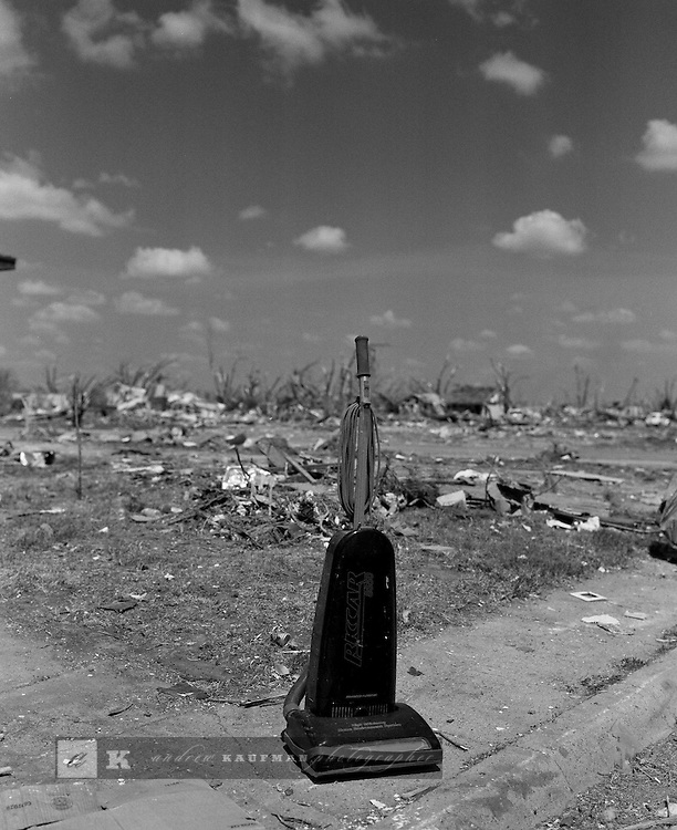 A vacuum cleaner left in the wreckege of the tornado that hit Greensburg, KA.