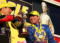 Feb 14, 2016; Pomona, CA, USA; NHRA funny car driver Ron Capps (right) celebrates with pro stock driver Greg Anderson after winning the Winternationals at Auto Club Raceway at Pomona. Mandatory Credit: Mark J. Rebilas-USA TODAY Sports