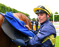Jockey Kieran Shoemark unsaddles Polish in the winners enclosere after winning The Sorvio Insurance Brokers Maiden Stakes (Plus 10)  during Afternoon Racing at Salisbury Racecourse on 12th June 2018