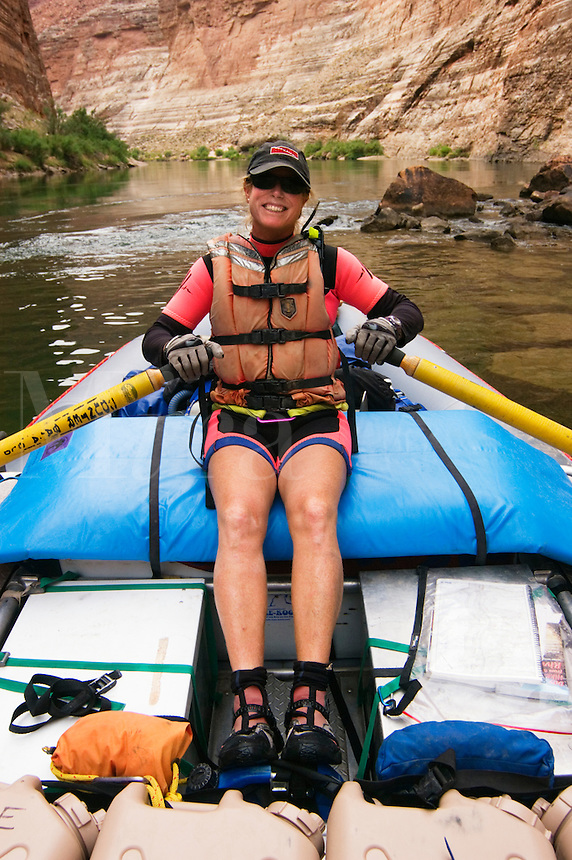 Raft guide Bonnie Pearsons approaches REDWALL CAVERN, a large cave found at mile 33 along the Colorado River - GRAND CANYON,  ARIZONA