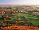 Autumnal landscape Scotland looking down on Sweetheart Abbey in amoungest a patchwork agricultural landscape of fields near Dumfries UK
