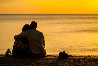 UK Weather: Aberystwyth, Ceredigion, West Wales. Sunday 9th May 2016 with temperatures topping 25 bought people out, like this couple to enjoy the stunning sunset.