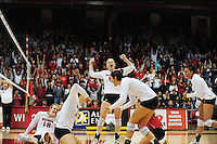 The Badgers celebrate a close win over the Wolverines, as the Wisconsin volleyball team tops Michigan 3 sets to 1 at the UW Field House on Saturday in Madison