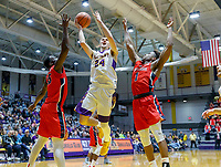 Stony Brook defeats UAlbany  69-60 in the America East Conference tournament quaterfinals at the  SEFCU Arena, Mar. 3, 2018.  Joe Cremo (#24) drives between Akwasi Yeboah (#15) and UC Iroegbu (#1).