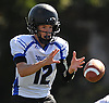 Jay Moorwood #12, Centereach quarterback, takes a snap during a Suffolk County Division II varsity football game against host Copiague High School on Saturday, Sept. 24, 2016. Centereach won by a score of 26-0.