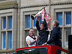 Paul Coutts of Sheffield Utd lifts up the league one trophy watched by Billy Sharp and Chris Wilder during the open top bus parade from Bramall Lane Stadium to Sheffield Town Hall, Sheffield. Picture date: May 2nd 2017. Pic credit should read: Simon Bellis/Sportimage