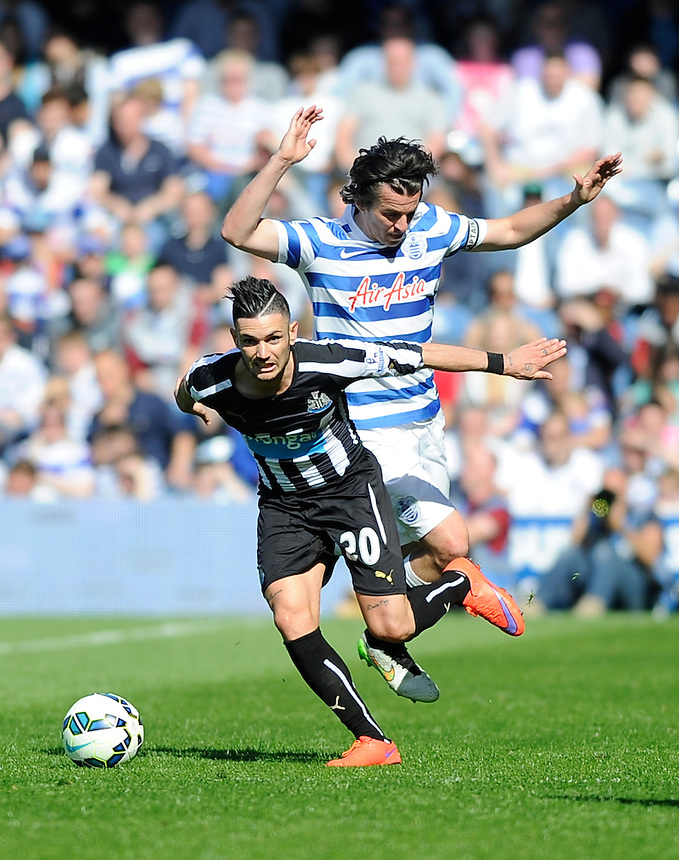 Newcastle United's Remy Cabella holds off the challenge from Queens Park Rangers' Joey Barton<br /> <br /> Photographer Ashley Western/CameraSport<br /> <br /> Football - Barclays Premiership - Queens Park Rangers v Newcastle United - Saturday 16th May 2015 - Loftus Road - London<br /> <br /> &copy; CameraSport - 43 Linden Ave. Countesthorpe. Leicester. England. LE8 5PG - Tel: +44 (0) 116 277 4147 - admin@camerasport.com - www.camerasport.com