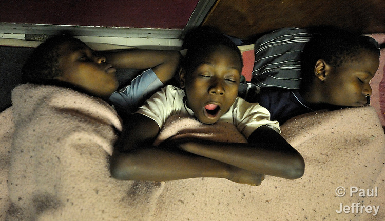 Refugee children from Zimbabwe sleep at night on the floor of the Central Methodist Church in Johannesburg, South Africa. The church is home to more than 3,000 refugees suffering from economic desperation and sporadic xenophobic attacks.