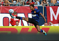 Manchester United midfielder Nani (17) leaps high in the air at full stretch to receive the ball.  Manchester United defeated the Chicago Fire 3-1 at Soldier Field in Chicago, IL on July 23, 2011.