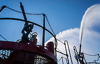 The water cannons of fireboat John J. Harvey fire a salute on the Hudson River in New York on Saturday, June 25, 2016. Built in 1931 the boat was retired from the FDNY in 1994. The boat was reactivated on Sept. 11, 2001 and with other fireboats pumped water continuously for 80 hours until the mains were restored. Privately owned, the ship gives educational tours and recreational tours. (© Richard B. Levine)