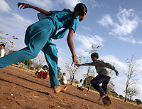 Students play a game during a physical education class at the Vimochana School in Malabad, India.  The school was the first residential school for the children of Devadasis and was founded in 1990 to break the cycle of the Devadasi system.  Because the belief is that all female children of Devadasis should themselves become Devadasis, the school was created to remove the children from the culture in which this practice took place and instead offer them an education.  All students receive free tuition, books, uniforms, food and medical care. .