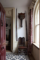 The entrance hall is decorated with a collection of hunting trophies, many from Africa