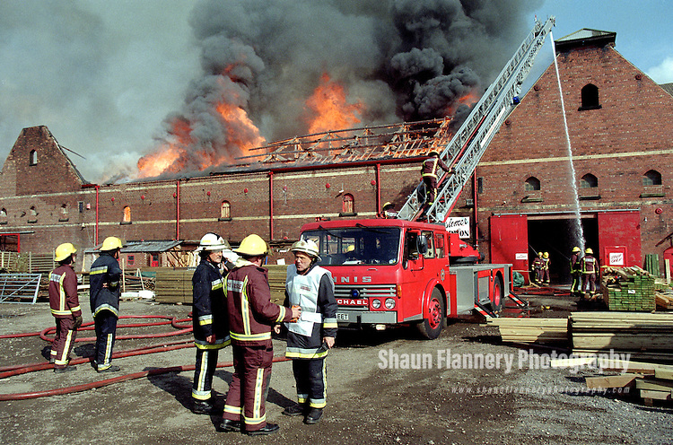 Pix: Shaun Flannery/shaunflanneryphotography.com...COPYRIGHT PICTURE>>SHAUN FLANNERY>01302-570814>>07778315553>>..1st July 1999..Firefighters tackle a blaze at Maltings Timber Merchants building at Kirk Sandall nr. Doncaster.
