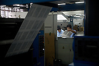 "Press technicians check the quality of Bible pages as they come off a new printing press in the Amity Printing Company's new printing facility in Nanjing, China....On May 18, 2008, the Amity Printing Company in Nanjing, Jiangsu Province, China, inaugurated its new printing facility in southern Nanjing.  The facility doubles the printing capacity of the company, now up to 12 million Bibles produced in a year, making Amity Printing Company the largest producer of Bibles in the world.  The company, in cooperation with the international organization the United Bible Societies, produces Bibles for both domestic Chinese use and international distribution.  The company's Bibles are printed in Chinese and many other languages.  Within China, the Bibles are distributed both to registered and unregistered Christians who worship in illegal ""house churches."""