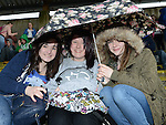 Aisling Eaton, Leah Byrne and Niamh Markey from Tullyallen Foroige club brave the weather at Foroigefest 2013 held at Bellewstown race course. Photo:Colin Bell/pressphotos.ie