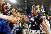 Jan 10, 2011; Glendale, AZ, USA; Auburn Tigers quarterback Cameron Newton (2) greets fans in the stands after defeating the Oregon Ducks 22-19 in the 2011 BCS National Championship game at University of Phoenix Stadium.  Mandatory Credit: Mark J. Rebilas-