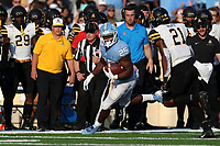 CHAPEL HILL, NC - SEPTEMBER 21: Javonte Williams #25 of the University of North Carolina runs the ball during a game between Appalachian State University and University of North Carolina at Kenan Memorial Stadium on September 21, 2019 in Chapel Hill, North Carolina.