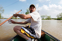 Joshua Robertson paddles through the Mississippi River floodwater covering the Red Star district Cape Girardeau, MO, on Thursday, April 28, 2011.