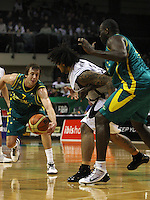 Boomers forward Joe Ingles steals off BJ Anthony, as Nathan Jawai (right) helps out during the International basketball match between the NZ Tall Blacks and Australian Boomers at TSB Bank Arena, Wellington, New Zealand on 25 August 2009. Photo: Dave Lintott / lintottphoto.co.nz