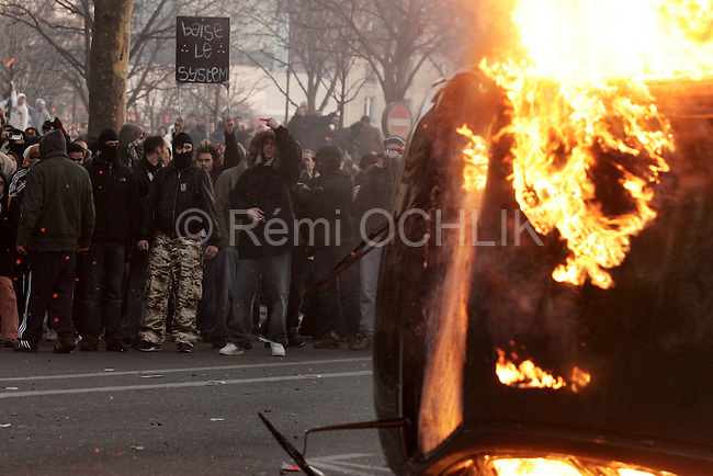 """France Student Clashes..French students and security forces clash on the """"place of the nation"""" as students protest against the new CPE labor law in Paris, France, on saturday, March 18, 2006. The new law, that is designed to combat the high youth unemployment, is a permanent contract for those under 26, it allows employers to terminate employment at any moment within 2 years. ....The contrat premiere embauche (CPE), translated first employment contract, was a new form of employment contract pushed in spring 2006 in France by Prime Minister Dominique de Villepin. This employment contract, available solely to employees under 26, would have made it easier for the employer to fire employees by removing the need to provide reasons for dismissal for an initial """"trial period"""" of two years, in exchange for some financial guarantees for employees. ....The law has met heavy resistance from students, trade unions, and left-wing activists, sparking protests in February and March 2006 (and continuing into April) with hundreds of thousands of participants in over 180 cities and towns across France"""