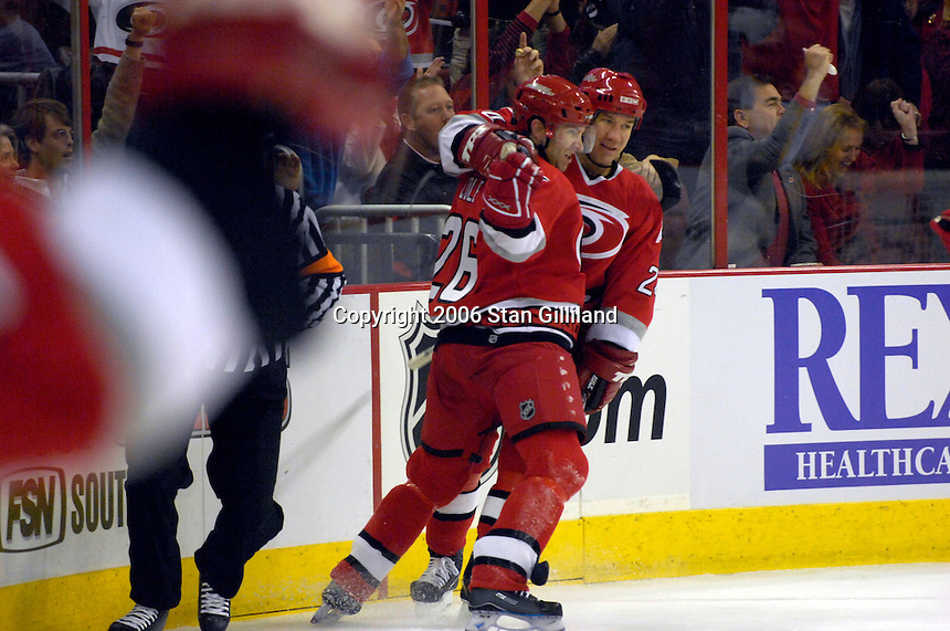 Carolina Hurricane's Erik Cole (26) celebrates his goal against the Boston Bruins with teammate Scott Walker during an NHL hockey game Saturday, Dec. 2, 2006 in Raleigh, N.C. Carolina won 5-2.<br />