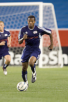 Kerry Zavagnin (Wizards) beats Clint Dempsey (Revolution). The Kansas City Wizards defeated the NE Revolution, 2-1, on August 6 at Gillette Stadium.