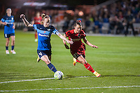 Kansas City, Mo. - Saturday April 23, 2016: FC Kansas City defender Becky Sauerbrunn (4) attempts to dribble past Portland Thorns FC forward Hayley Raso (21) during a match at Swope Soccer Village. The match ended in a 1-1 draw.