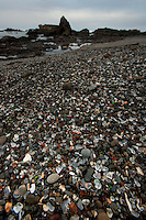 Glass beach at Fort Bragg in Northern California. An old junkyard full of glass bottles that eroded away in the pounding surf.